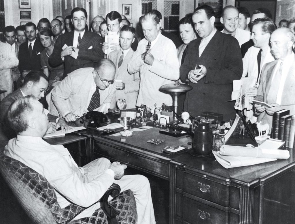 Reporters at Presidents Roosevelt's Desk in 1944.