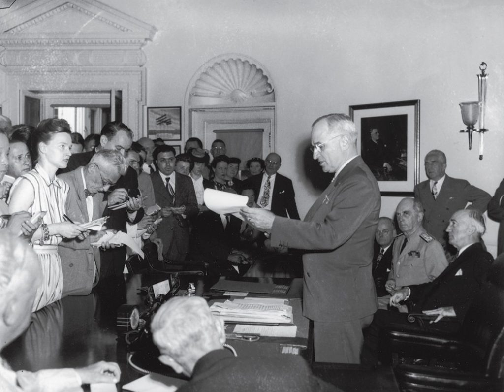 Reporters surrounding President Truman's desk, 1945
